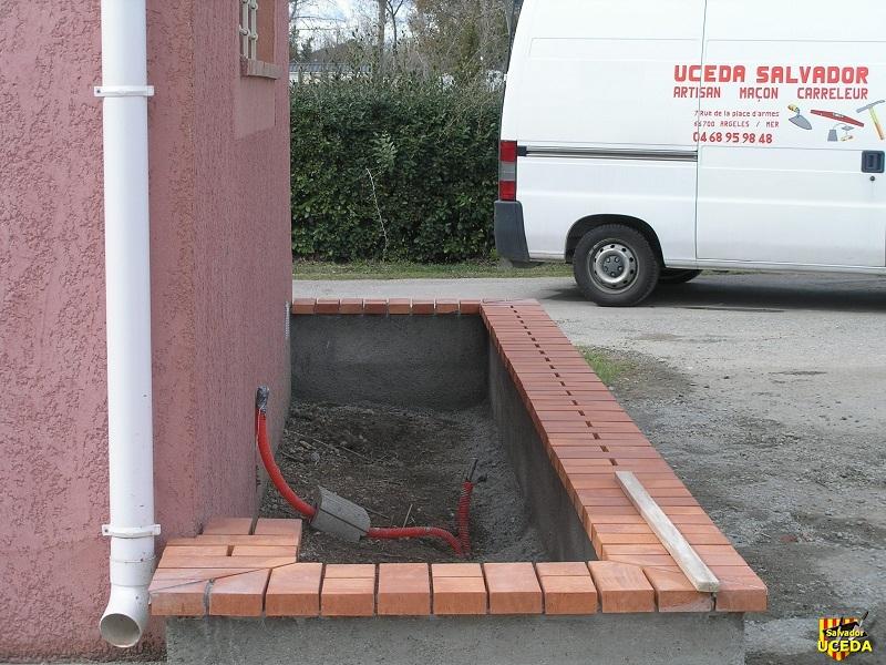 Jardinière rectangulaire en pied de façade
